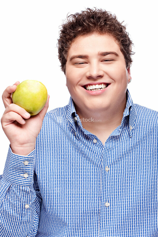 chubby man holding apple