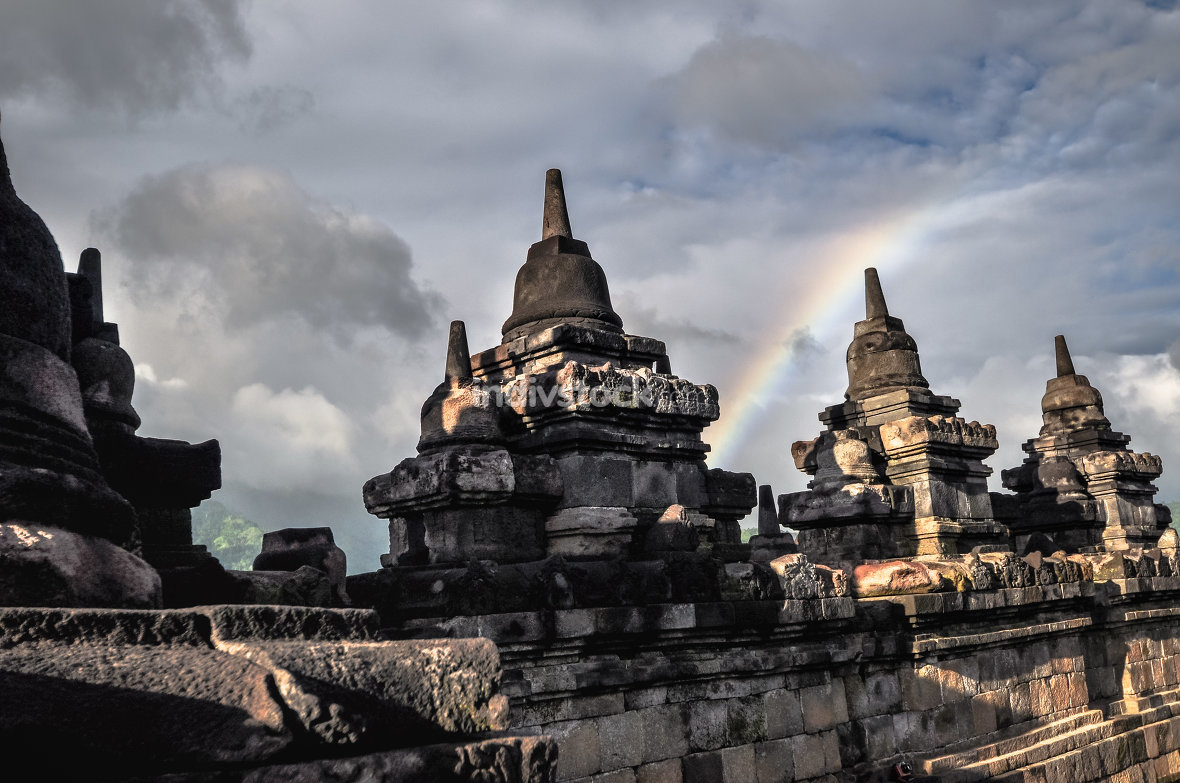 Clouds and Rainbow Buddist temple Borobudur complex in Yogjakart