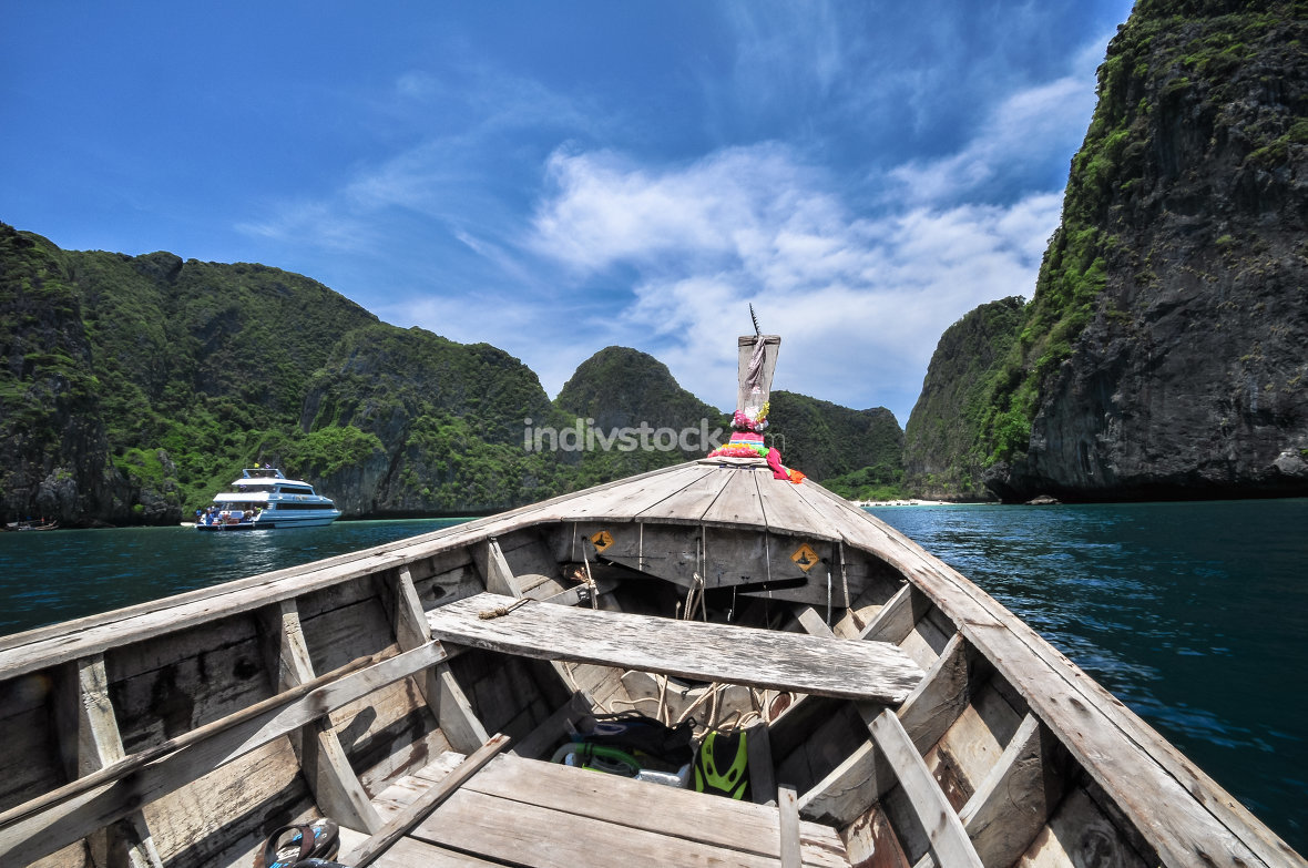 Traditional wooden boats in a picture perfect tropical Maya bay