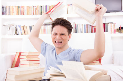 angry student  surrounded by books  throws books