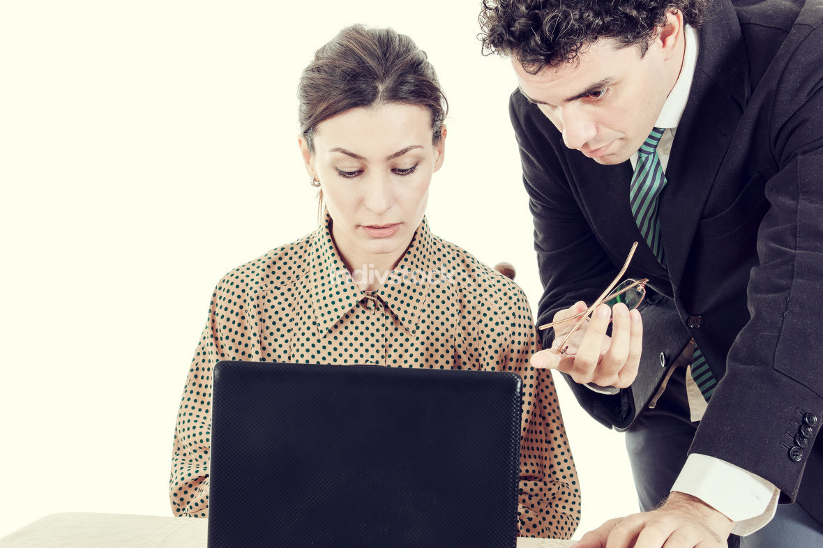 Boss and secretary working together on laptop