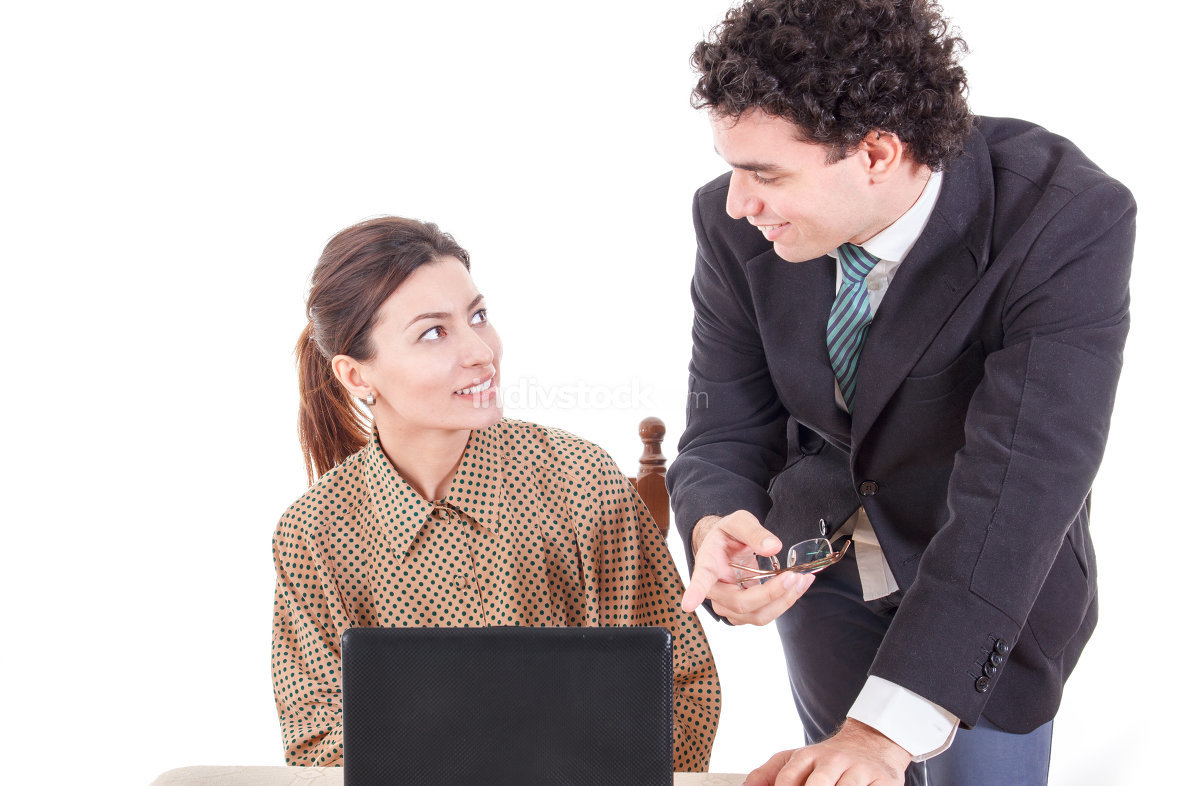 Boss and smiling secretary working together on laptop computer