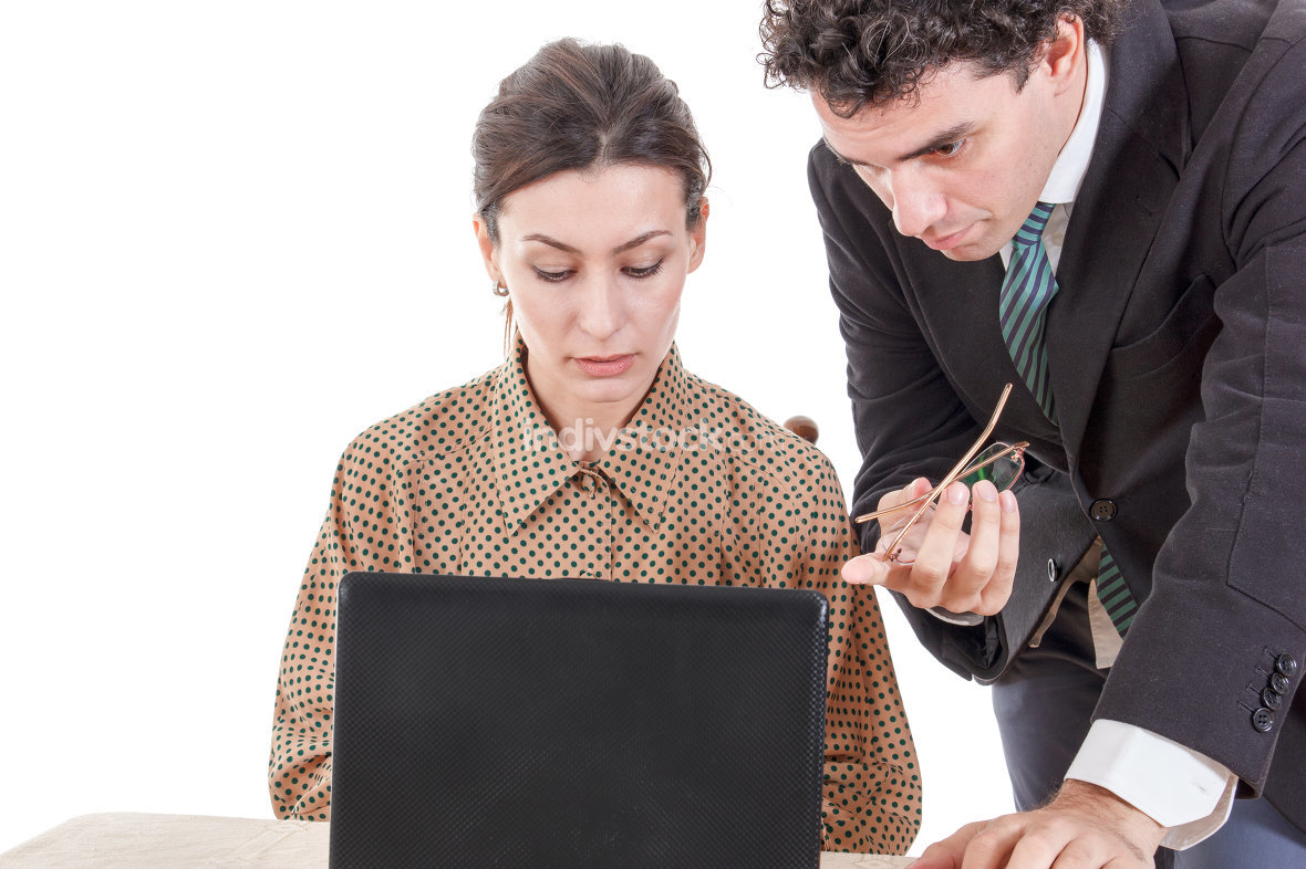 Boss and worried secretary working together on laptop