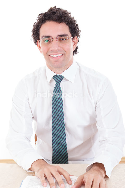 Happy business man wearing tie smiling reading book