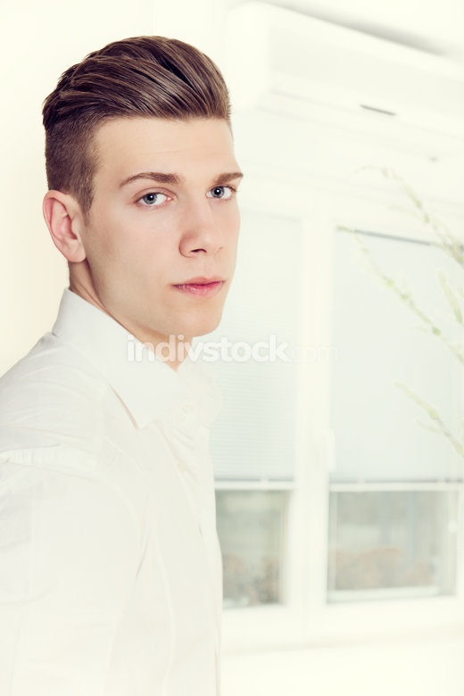 male model with modern haircut posing