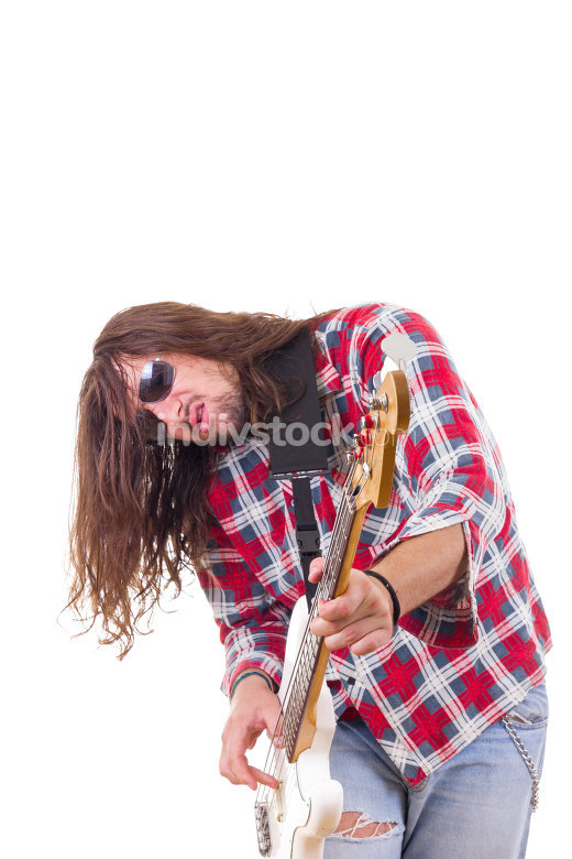 male musician with face expression playing electric bass guitar