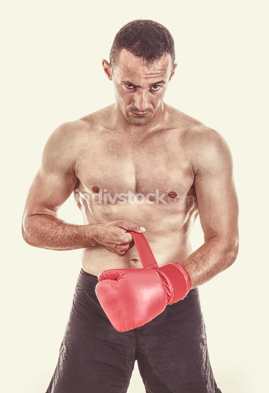 man putting his boxing gloves in front of camera
