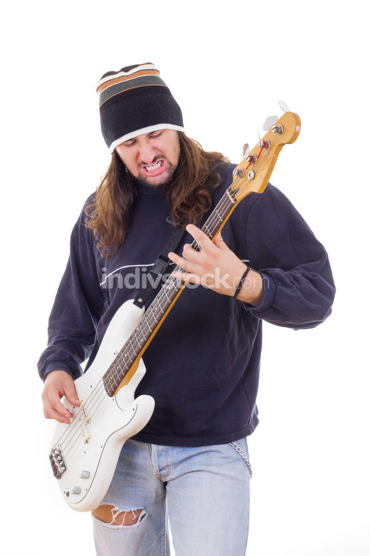 man with long hair playing a guitar