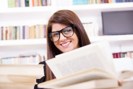 pretty female student with glasses smiling