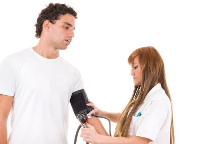 professional nurse measures the blood pressure of a patient