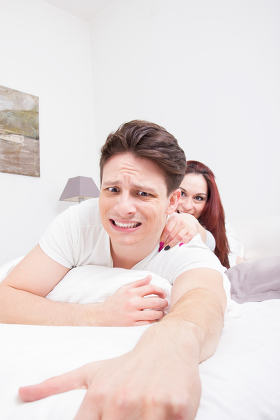 scared man trying to escape from woman