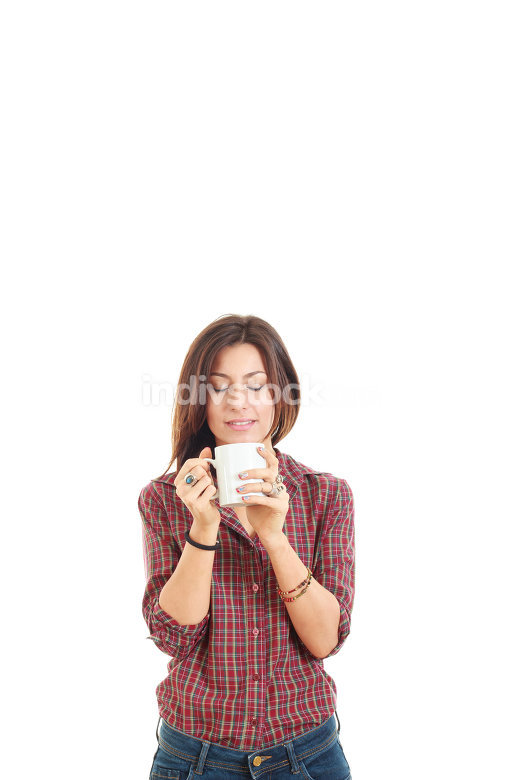 Attractive young woman enjoying the smell of coffee