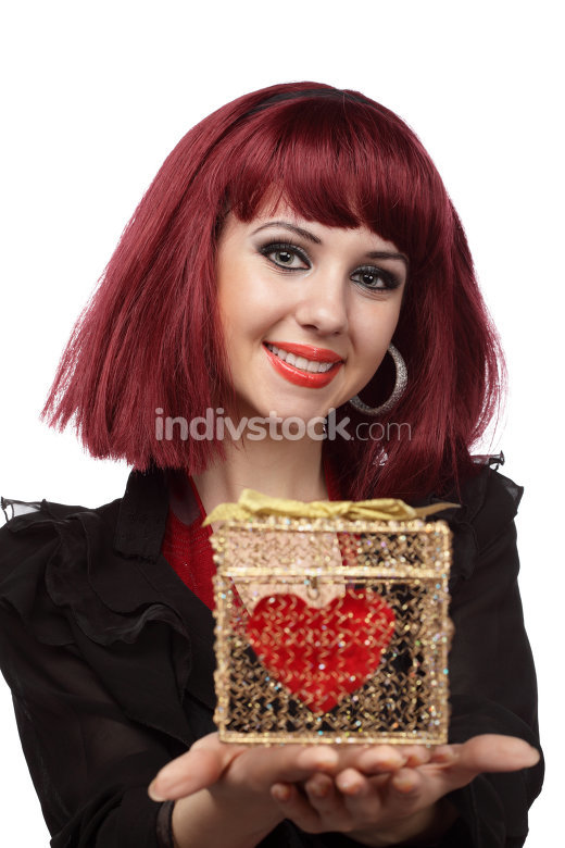 Beautiful woman with heart packed in a golden gift box
