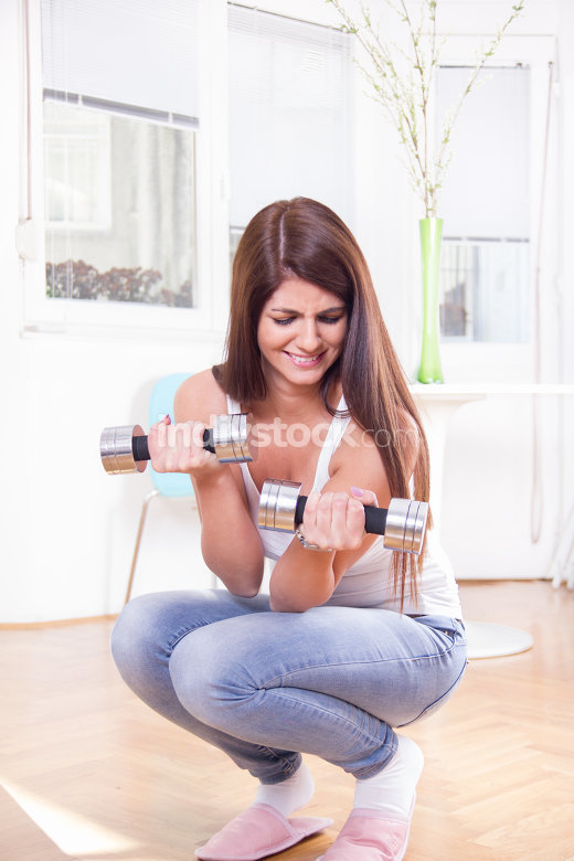 cute girl exercise with dumbbells