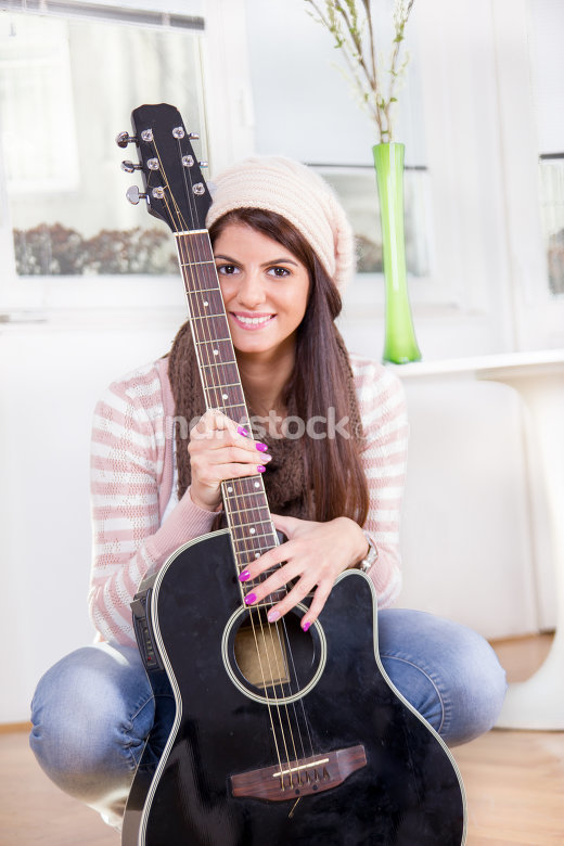 cute young girl holding the guitar
