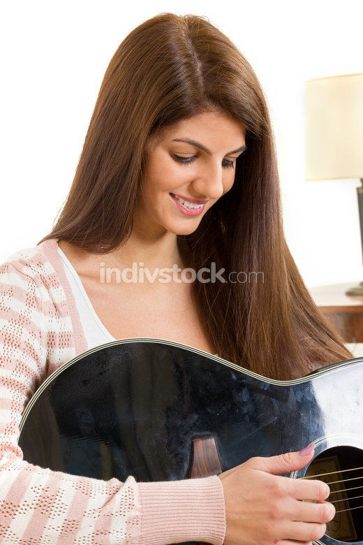 girl learning to play guitar