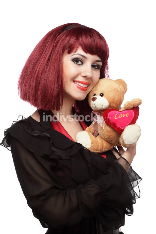 Happy girl with Teddy bear with heart in her hands