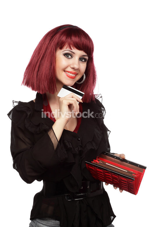 Happy woman holding credit card and wallet