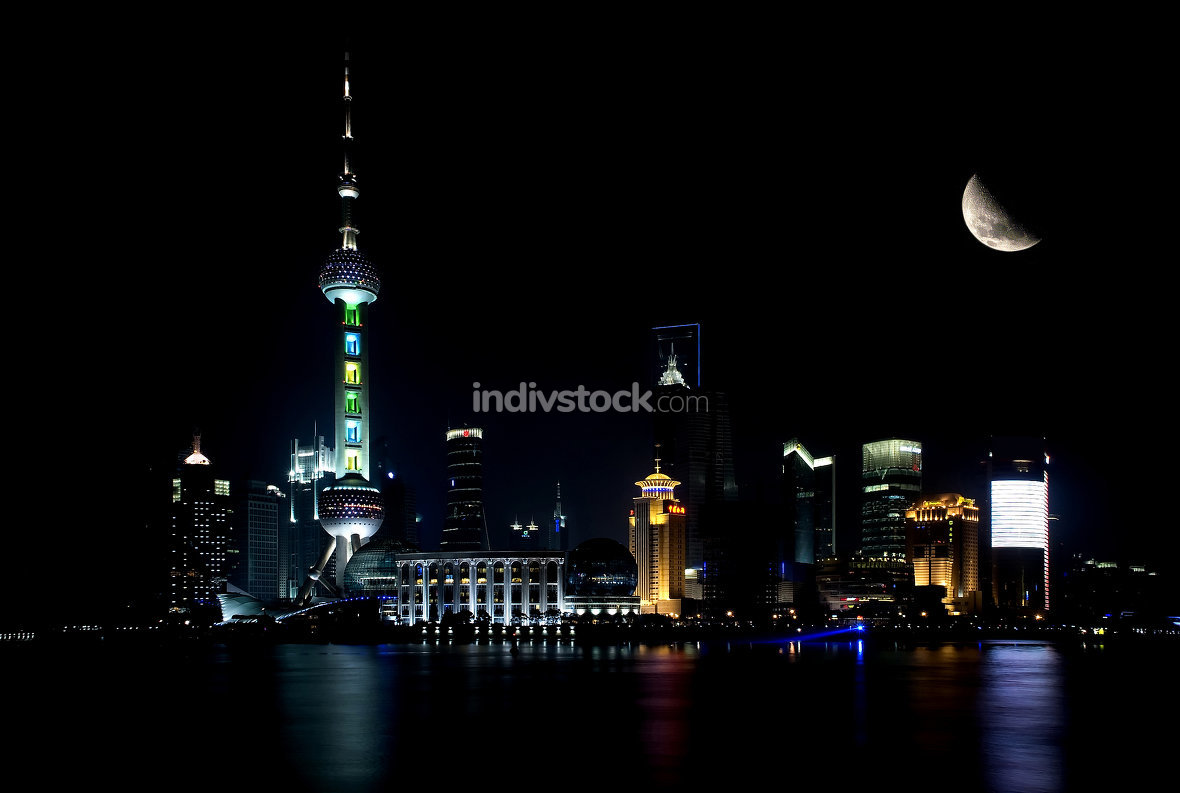 shanghai skyline by night with moon