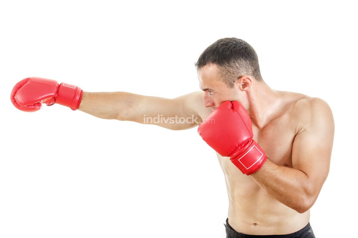 side view of muscular man wearing red boxing gloves and punching