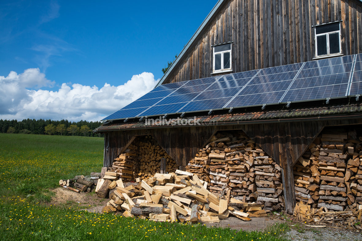 Solar roof and firewood in barn