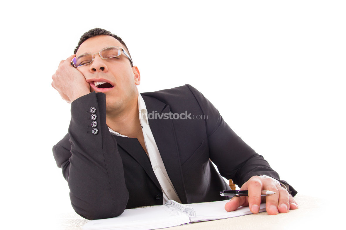 tired businessman sleeping at work yawning