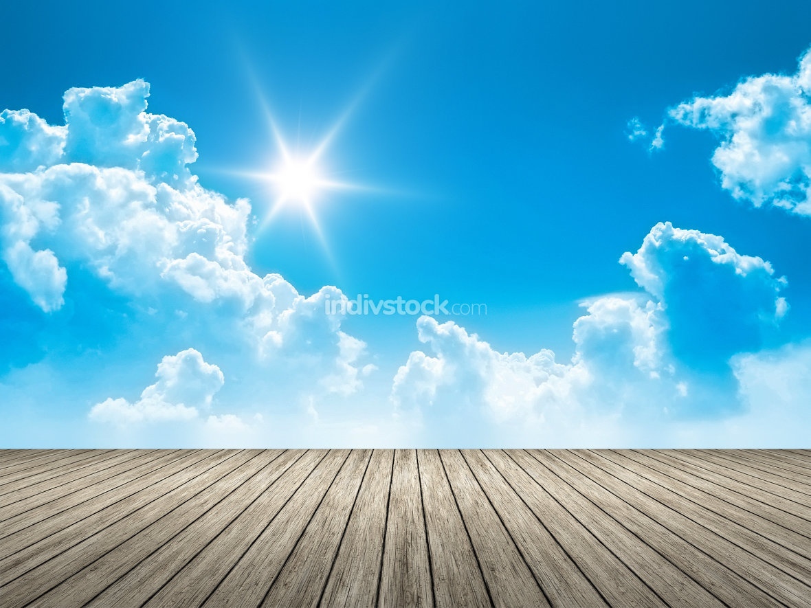 wooden jetty blue sky sun