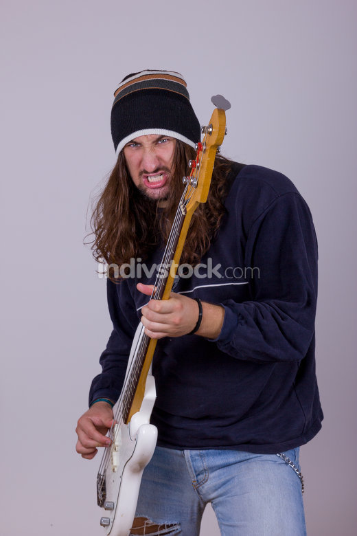 young man with bass guitar
