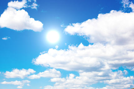Blue Sky With Clouds And Sun