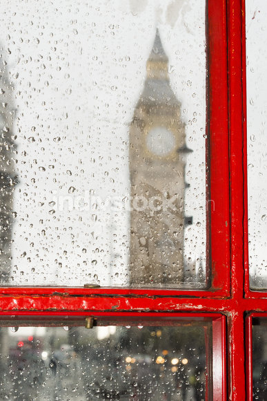 Big ben and red phone cabine. Rainy day