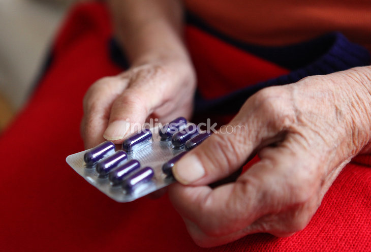 Close up of old hands with tablets