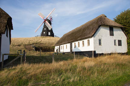 Windmill between houses