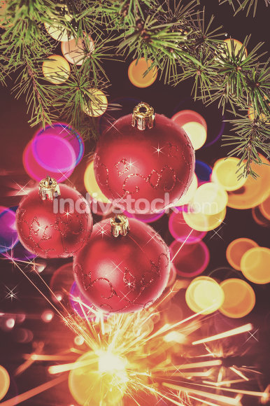 decoration with green pine or fir and red roud ball ornaments f