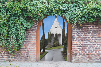 Photomontage, entrance gate in a wall