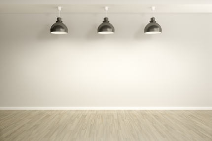 An image of an empty room with three lamps