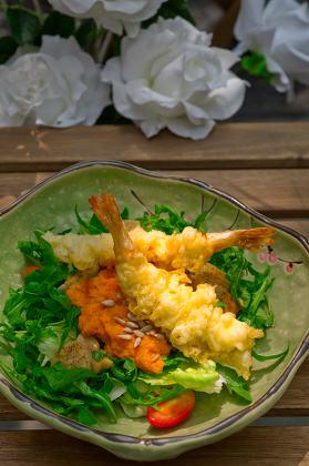 fresh Japanese tempura shrimps with salad