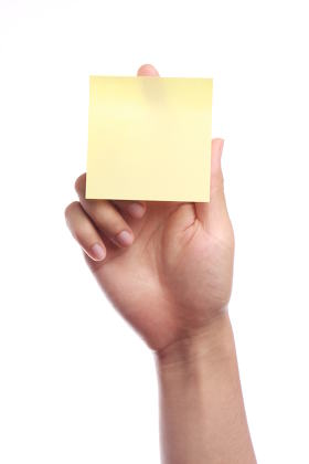 Hand With Yellow Sticky Note