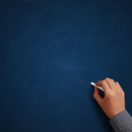 Hand writing on blank blue chalkboard