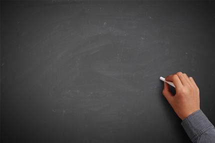 Hand writing on blank chalkboard