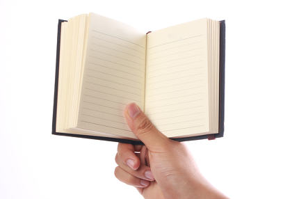 Holding Blank Note Book
