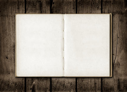 Note book on a dark wood background