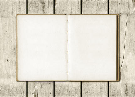 Note book on a white wood background