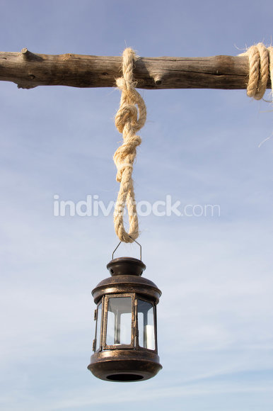 A lantern hanging on a dried branch