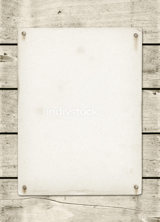 Blank vintage poster nailed on a white wood board