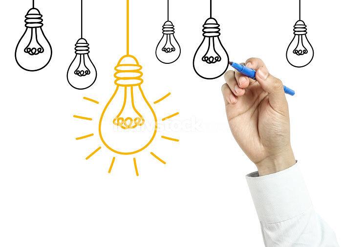 Businessman drawing light bulb concept