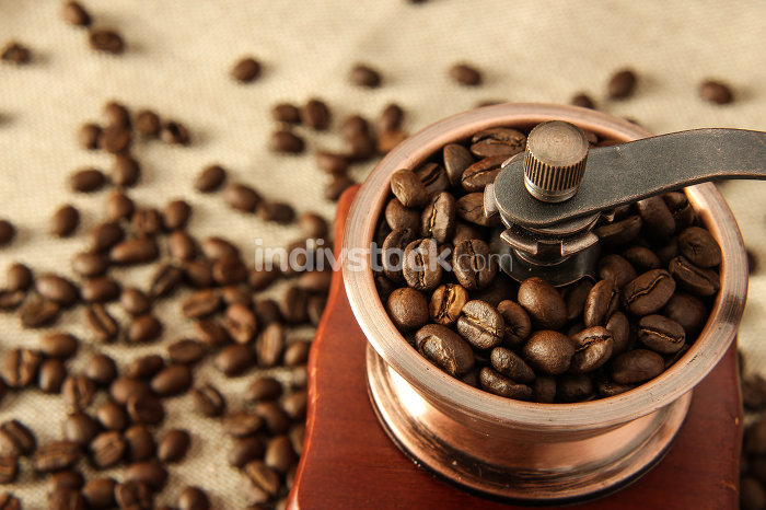 Closeup coffee bean and coffee grinder