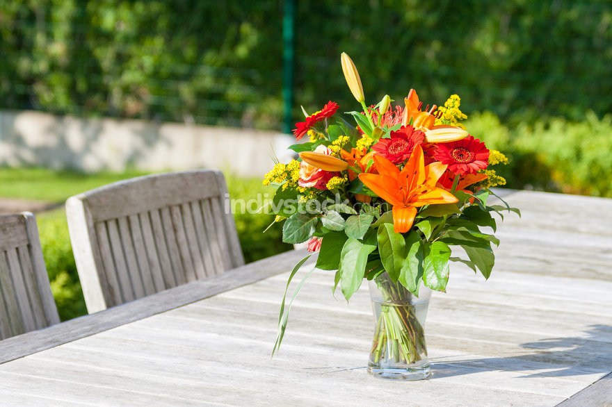 Colorful bouquet of flowers on the garden table