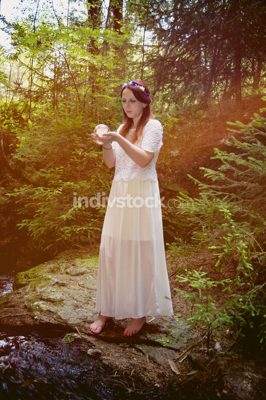 Fairy with glass ball