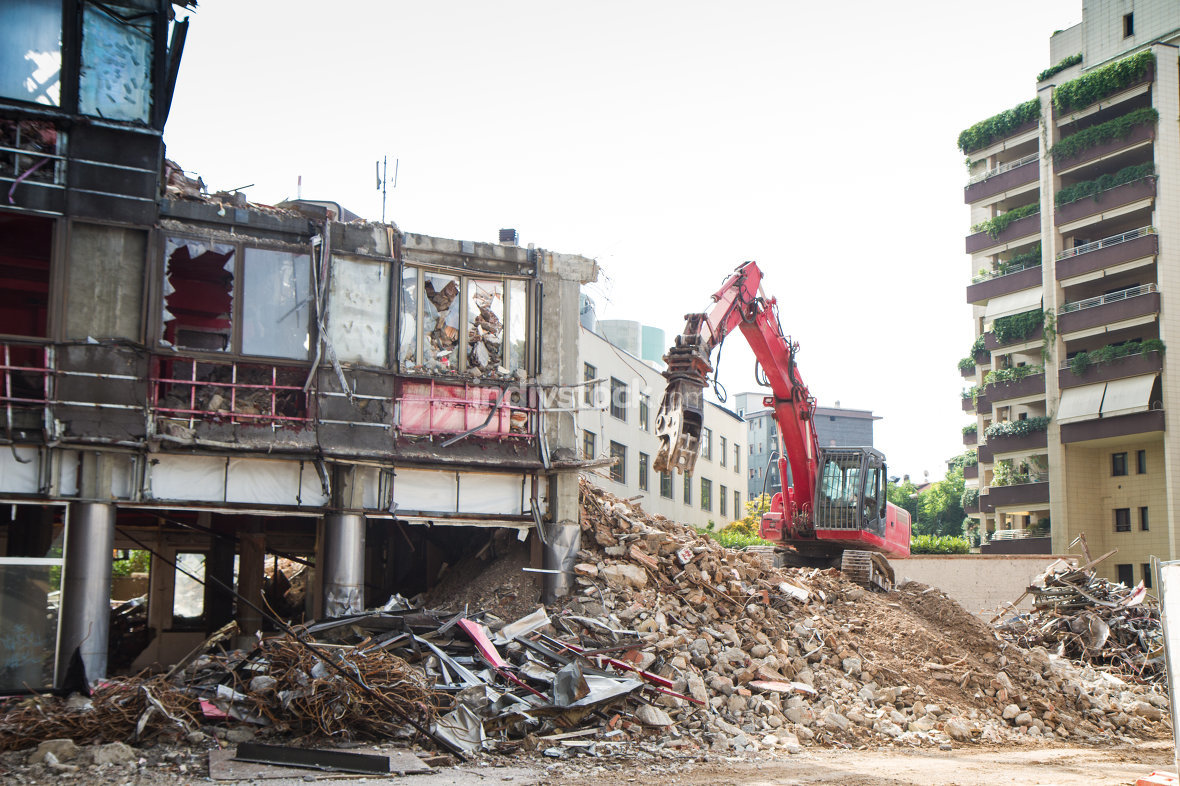 free download: crane and digger working on building demolition