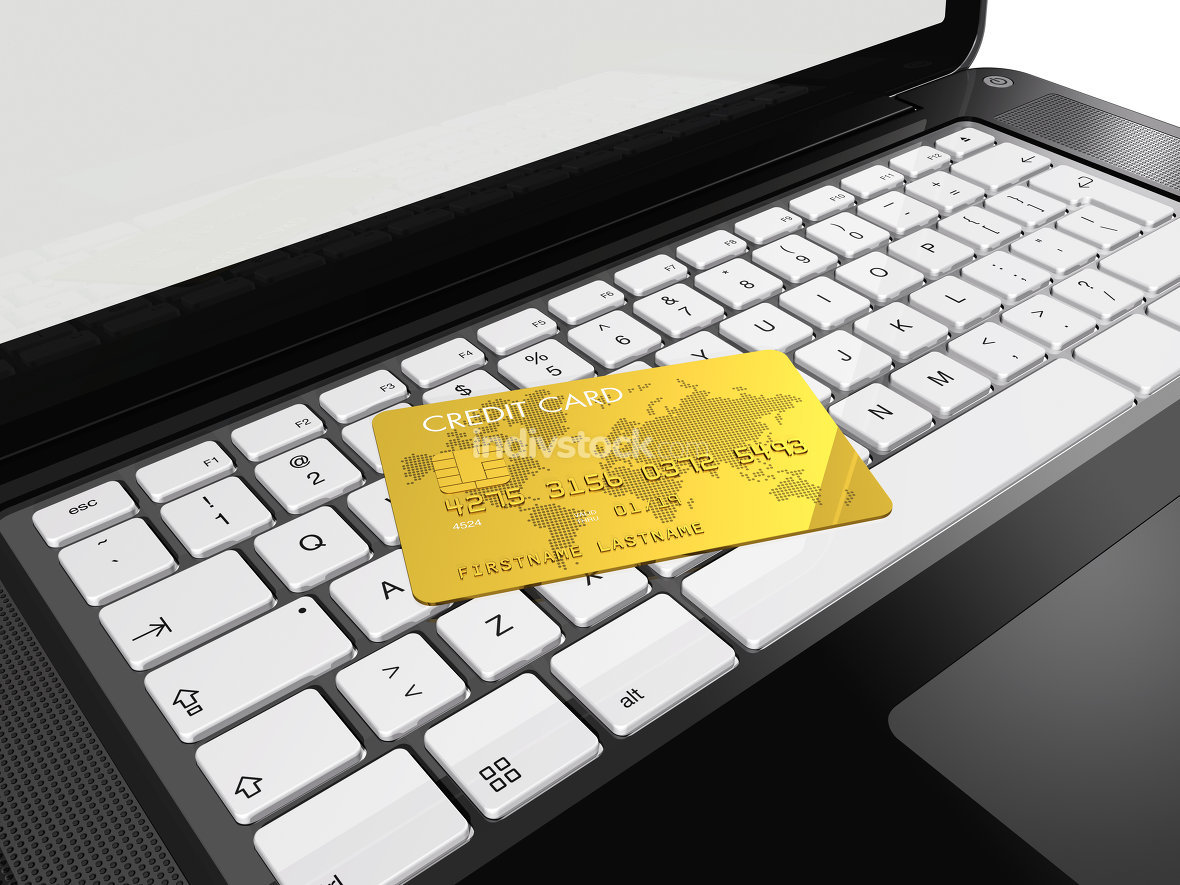 gold credit card on laptop